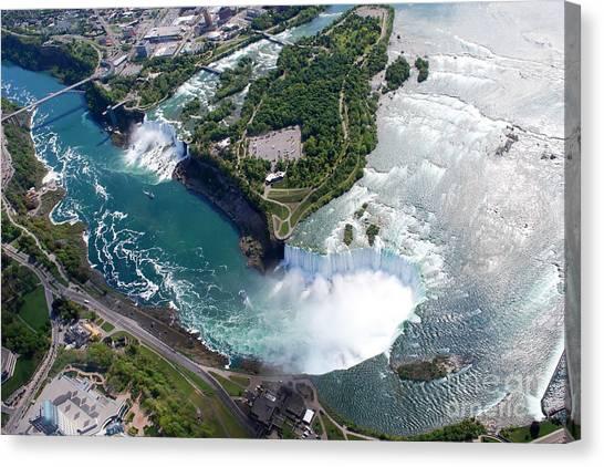 Stunning Canvas Print - Niagara Falls American And Canadian by Jiratthitikaln Maurice