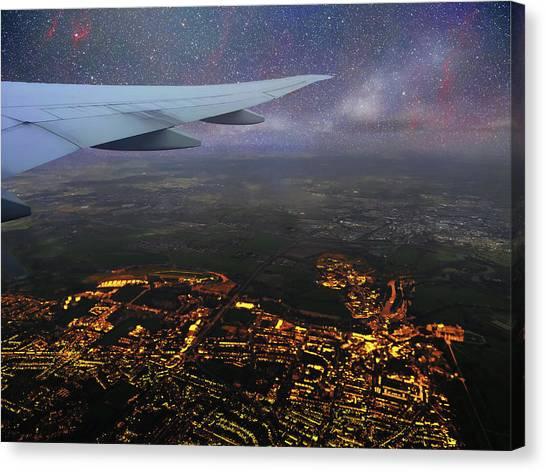 Night Flight Over City Lights Canvas Print