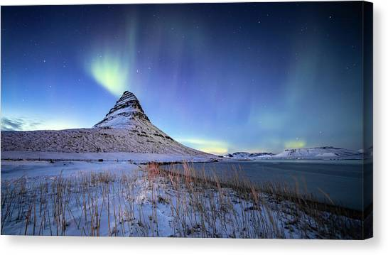Canvas Print featuring the photograph Northern Lights Atop Kirkjufell Iceland by Nathan Bush
