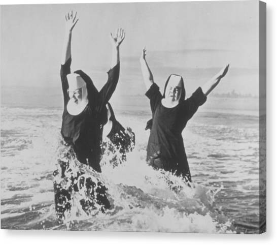 Nuns In The Surf Canvas Print