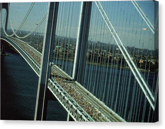 Nyc Marathon Runners On Bridge Canvas Print by Frederic Lewis