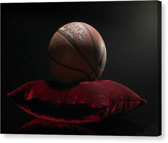 Old Basketball On Velvet Cushion Canvas Print