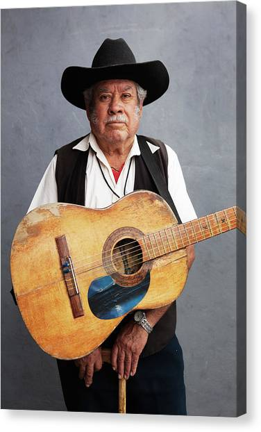 Old Man With His Hat, His Guitar And Canvas Print