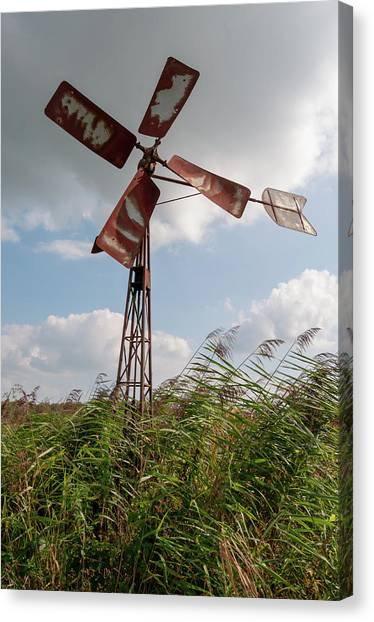 Canvas Print featuring the photograph Old Rusty Windmill. by Anjo Ten Kate
