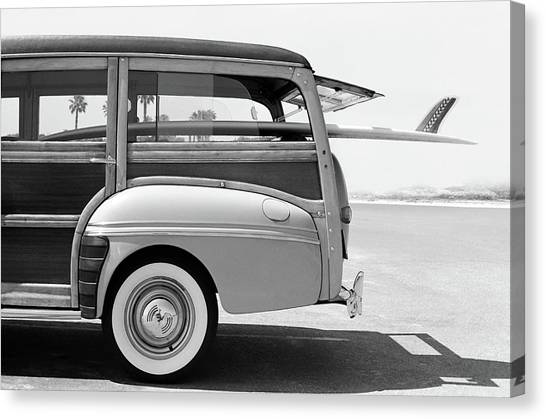 Old Woodie Station Wagon With Surfboard Canvas Print by Skodonnell