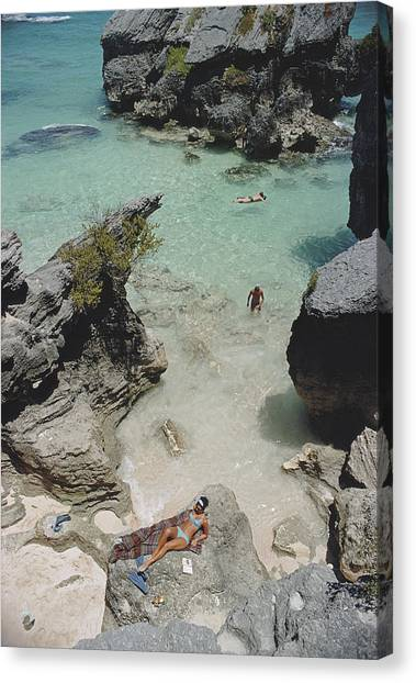 On The Beach In Bermuda Canvas Print by Slim Aarons