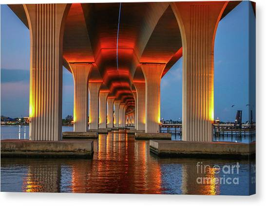 Canvas Print featuring the photograph Orange Light Bridge Reflection by Tom Claud
