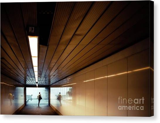 Passengers In A Hurry At The End Of A Tunnel At The Entrance To The Metro Station. Canvas Print