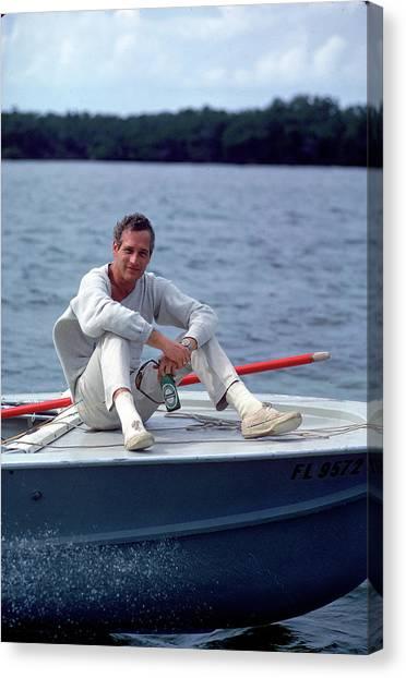 Paul Newman On Boat Canvas Print by Mark Kauffman