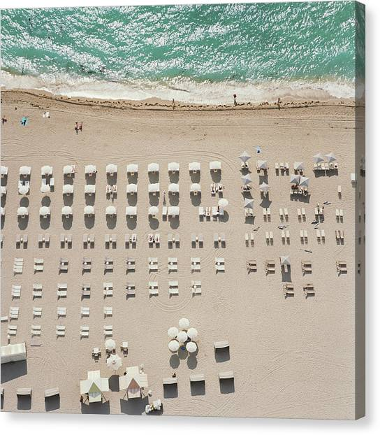 People At Beach, Using Rows Of Beach Canvas Print by John Humble