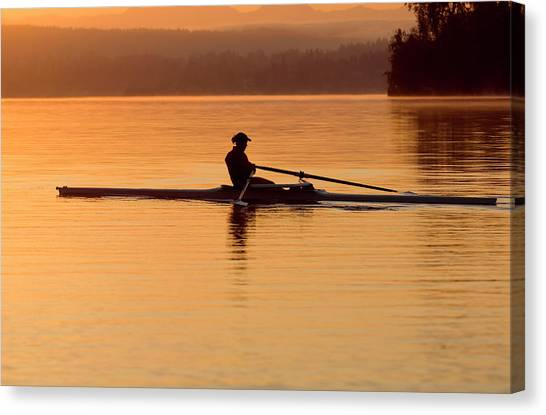 Person Rowing Sculling Boat On River Canvas Print by Pete Saloutos