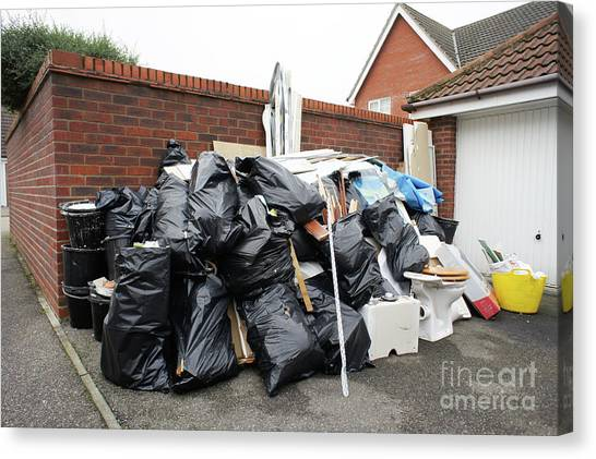 Rubbish Bin Canvas Print - Pile Of Household Waste by Tom Gowanlock
