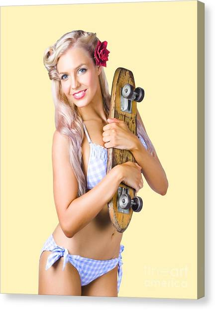 Canvas Print featuring the photograph Pinup Woman In Bikini Holding Skateboard by Jorgo Photography - Wall Art Gallery