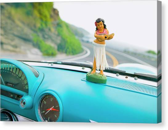 Plastic Hula Doll On The Dashboard Of A Canvas Print