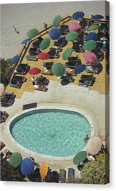 Pool At Carvoeiro Canvas Print by Slim Aarons