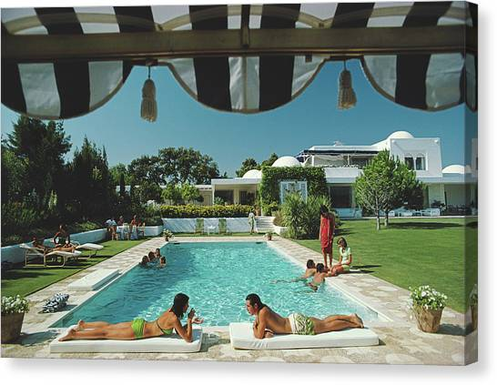 Poolside In Sotogrande Canvas Print by Slim Aarons