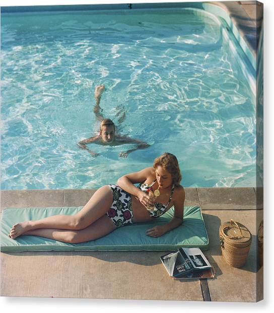 Poolside On Shelter Island Canvas Print by Slim Aarons