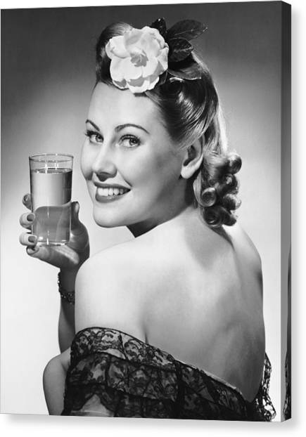 Portrait Of Woman Holding Glass Of Water Canvas Print