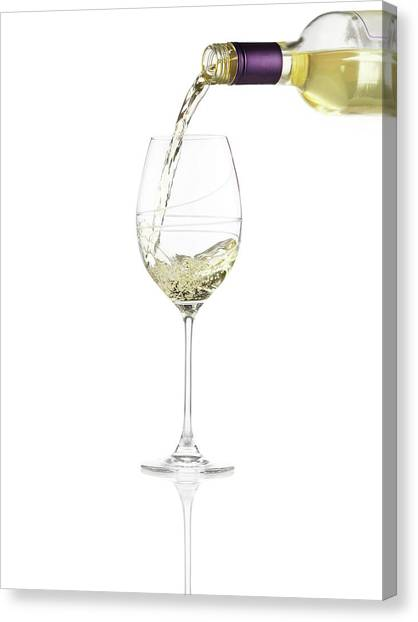Pouring A Glass Of White Wine Canvas Print
