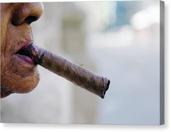 Profile Of Cuban Woman Smoking Cigar In Canvas Print by Christian Aslund
