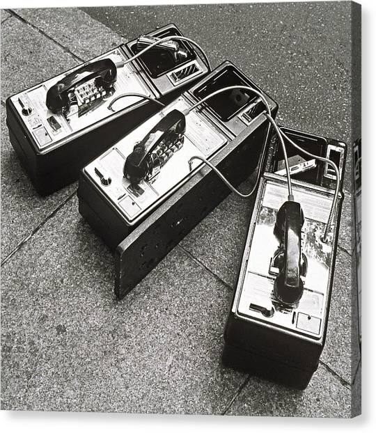 Public Phones Lying On Sidewalk Canvas Print