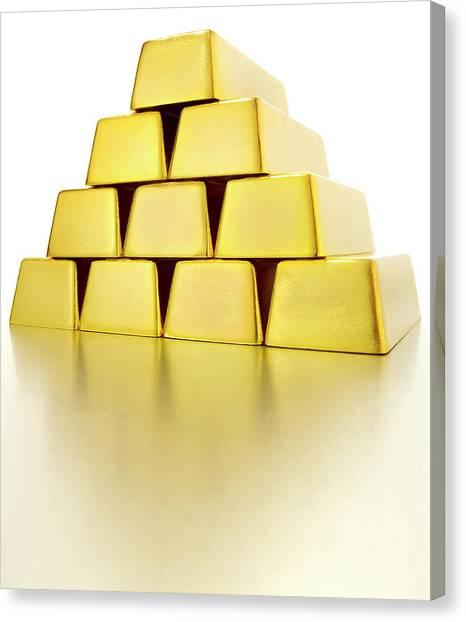 Pyramid Of Gold Bars Canvas Print by John Kuczala