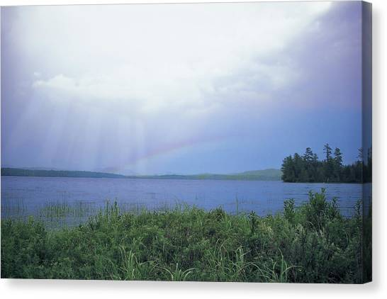 Canvas Print featuring the digital art Rainbow Over Raquette Lake by Christopher Meade