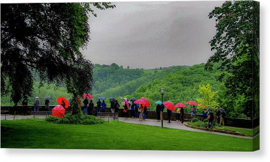 Canvas Print featuring the photograph Rainy Day Umbrellas by Phyllis Spoor