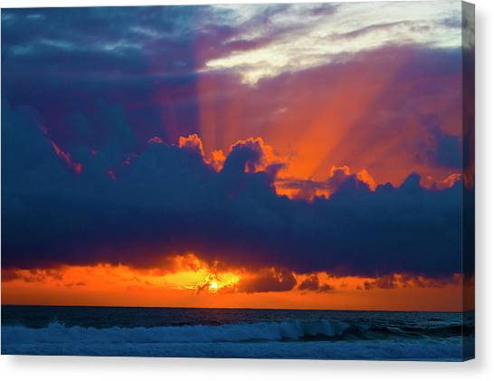 Sun Set Canvas Print - Rays Of Light Over The Ocean by Garry Gay