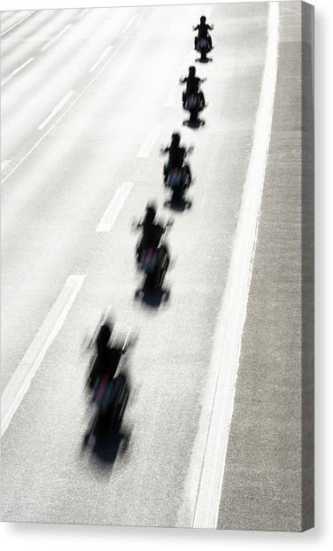 Rear View Of Row Of Motorcycle Riders Canvas Print