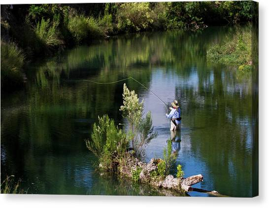 Rear View Of Woman Fly-fishing In The Canvas Print