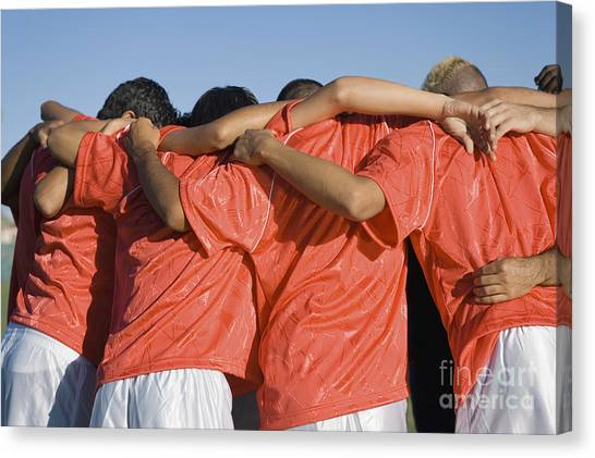 Rear View Of Young Soccer Players Canvas Print by Sirtravelalot