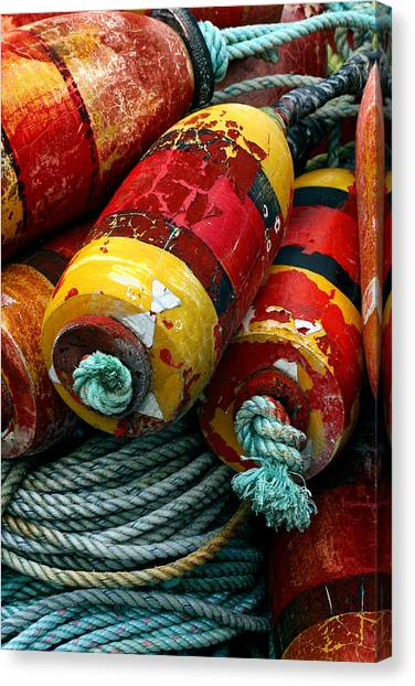 Crabbing Canvas Print - Red And Yellow Crab Pot Buoys by Carol Leigh