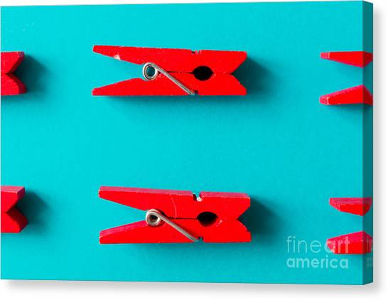 Red Clothespins On Cyan Background Canvas Print by Zamurovic Photography