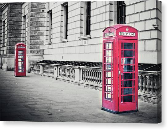 Red English Phone Booths In Black And Canvas Print