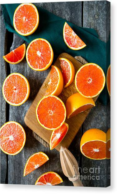 Utensil Canvas Print - Red Oranges On Wooden Surface by Diana Taliun