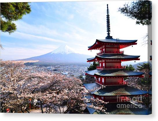 Cherry Blossom Canvas Print - Red Pagoda With Mt. Fuji As The by Sanupot