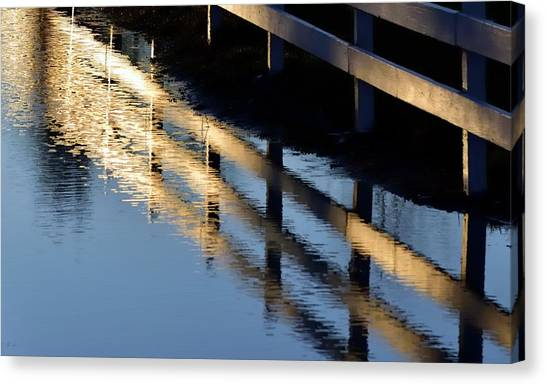 Canvas Print featuring the photograph Reflected Fence At Sunrise by Jerry Sodorff