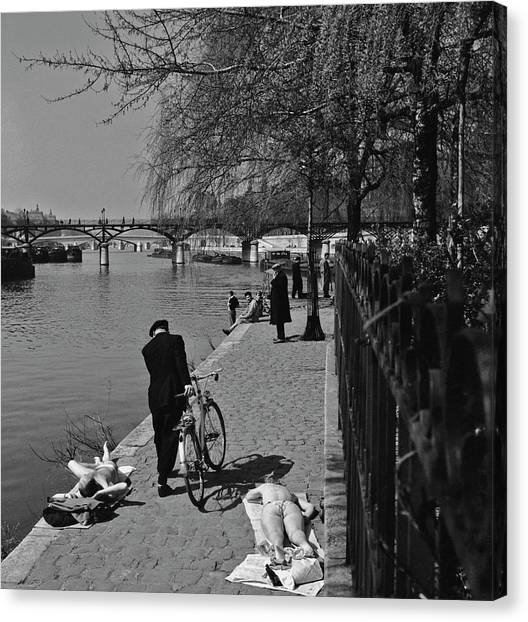 Relaxing By The Seine Canvas Print
