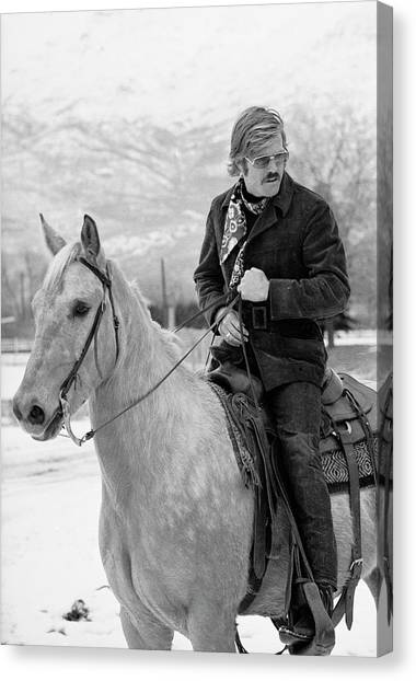 Robert Redford On A Horse Canvas Print by John Dominis