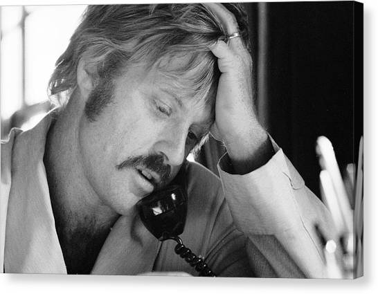 Robert Redford On The Phone Canvas Print by John Dominis