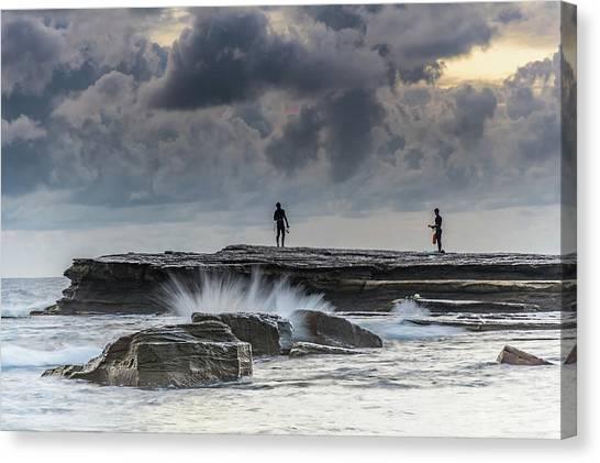 Rock Ledge, Spear Fishermen And Cloudy Seascape Canvas Print