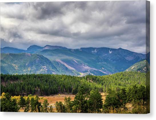 Canvas Print featuring the photograph Rockies - Clouds by James L Bartlett