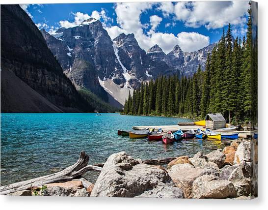 Canoe Canvas Print - Rocky Mountain View At Moraine Lake In by Treisdorfphoto