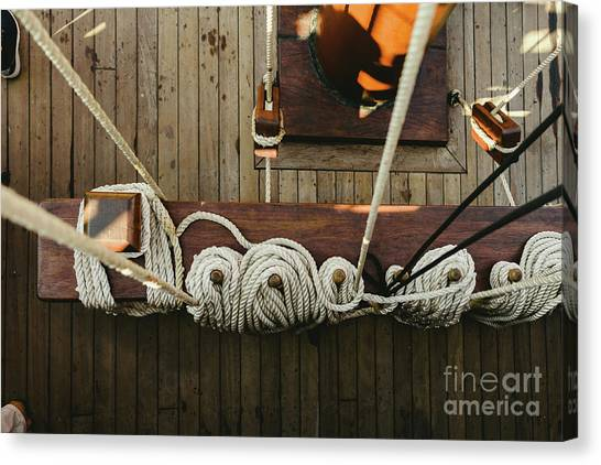 Ropes To Hold The Sails Of An Old Sailboat Rolled. Canvas Print