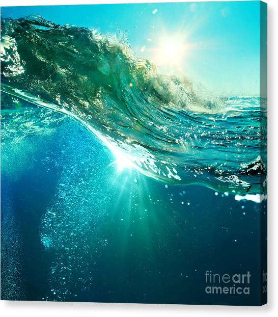 Tides Canvas Print - Rough Colored Ocean Wave Breaking Down by Willyam Bradberry