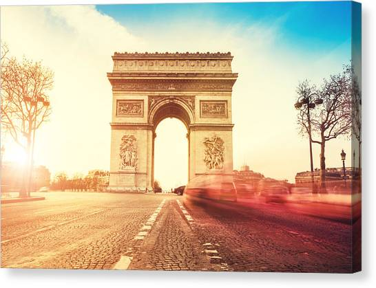 Rush Hour At The Arc De Triomphe In Canvas Print by Franckreporter
