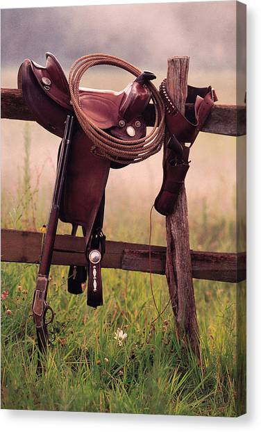 Saddle And Lasso On Fence Canvas Print by Comstock
