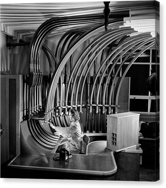 Secretary With Pneumatic Tube Canvas Print by Walter Nurnberg