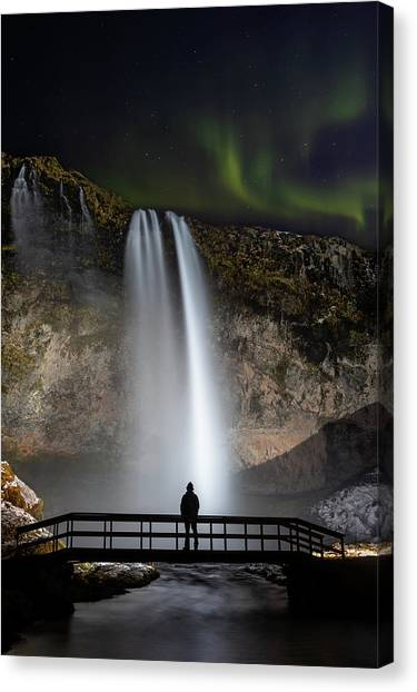 Canvas Print featuring the photograph Seljalandsfoss Northern Lights Silhouette by Nathan Bush